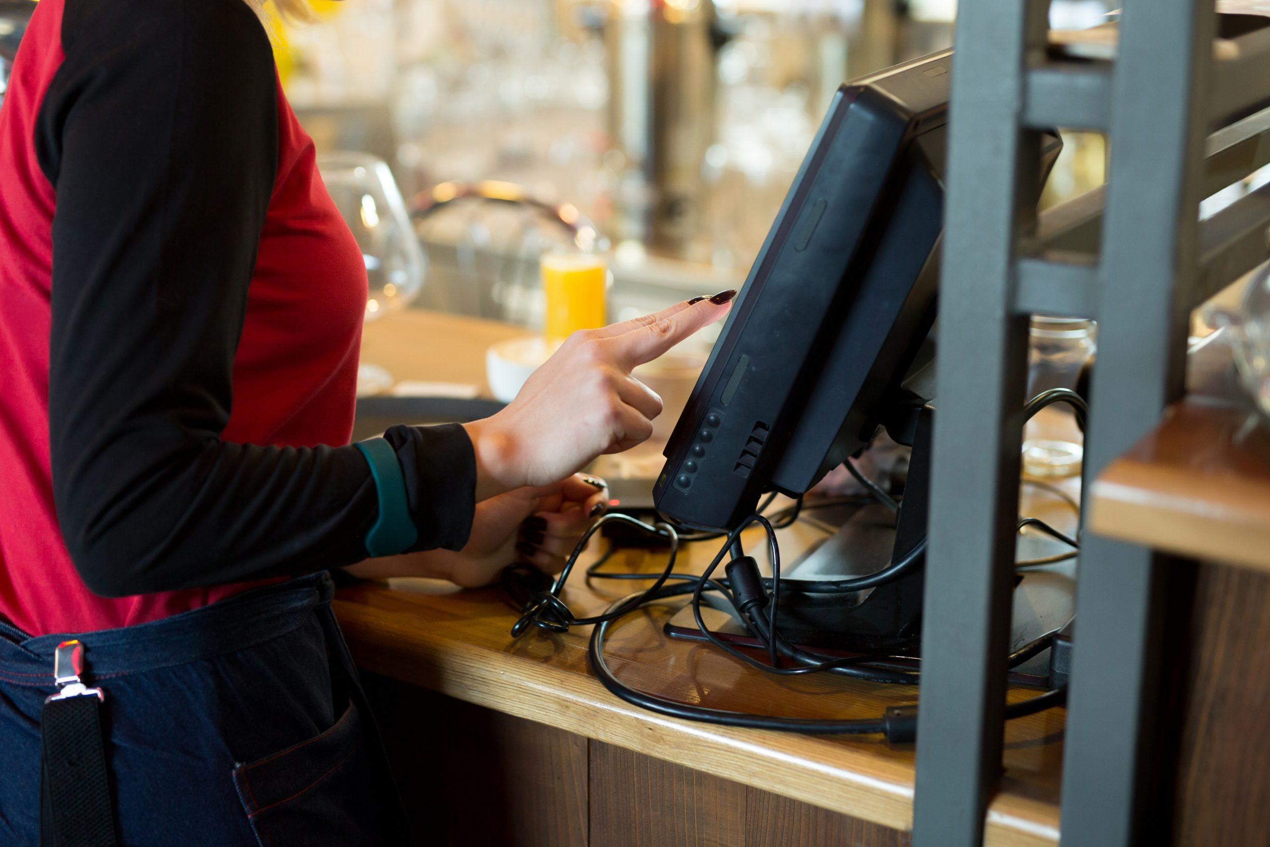 waiter-modern-cafe-bar-enters-order-payment-via-tablet-seekipper